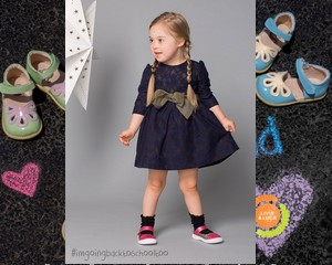 Down-szindrómás kislánnyal reklámozzák az iskolakezdést
